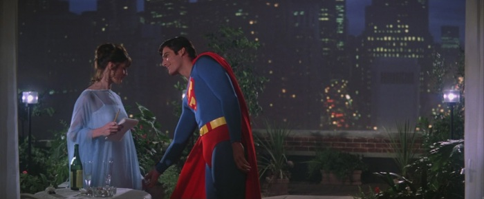 superman-1978-movie-christopher-reeve-as-superman-and-margot-kidder-as-lois-lane-on-balcony-with-city-background